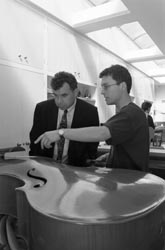 My brother, Christopher Walsh, and the Chancellor of West Dean College inspecting a bass he had built.